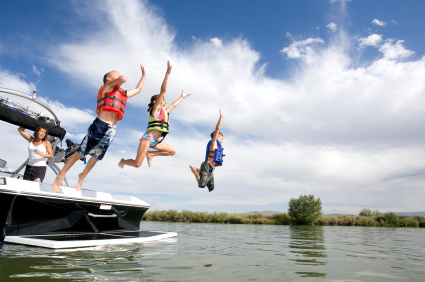 kids-jumping-off-ski-boat